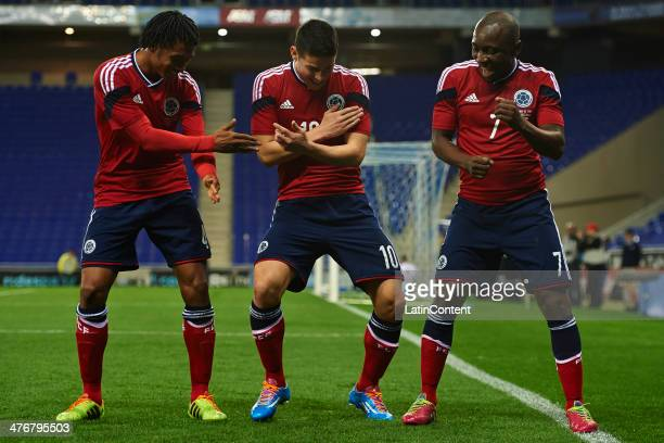 James Rodriguez of Colombia celebrates after scoring with his teammates Juan Guillermo Cuadrado of Colombia and Pablo Armero of Colombia during the...