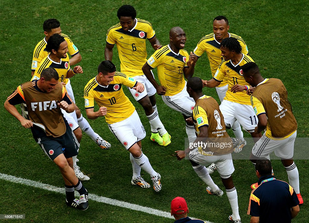 James Rodriguez #10 of Colombia celebrates by dancing with teammates after scoring his team's first goal during the 2014 FIFA World Cup Brazil Group C match between Colombia and Cote D'Ivoire at Estadio Nacional on June 19, 2014 in Brasilia, Brazil.