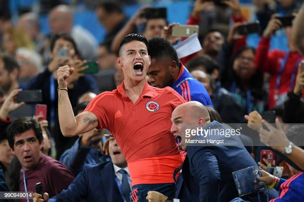James Rodriguez of Colombia celebrates from the crowd after teammate Yerry Mina scores their team's first goal during the 2018 FIFA World Cup Russia...