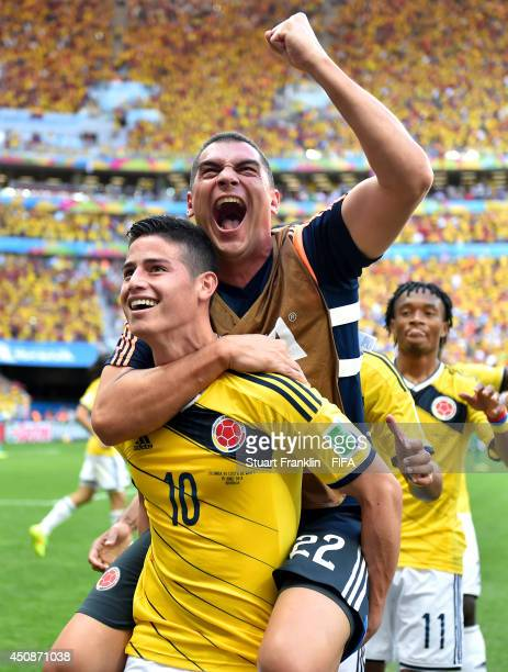 James Rodriguez of Colombia celebrates scoring his team's first goal with his teammate Faryd Mondragon during the 2014 FIFA World Cup Brazil Group C...