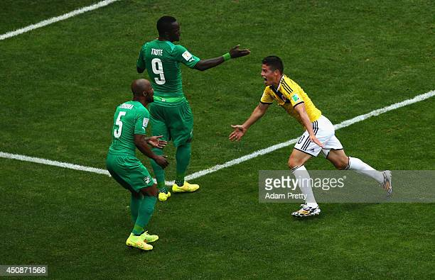James Rodriguez of Colombia celebrates scoring his team's first goal as Didier Zokora and Cheick Tiote of the Ivory Coast look on during the 2014...