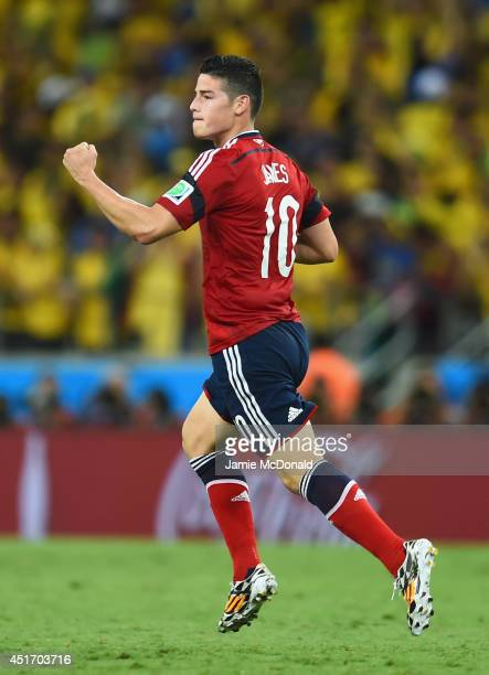 James Rodriguez of Colombia celebrates scoring his team's first goal on a penalty kick during the 2014 FIFA World Cup Brazil Quarter Final match...