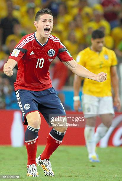 James Rodriguez of Colombia celebrates scoring his team's first goal from the penalty spot during the 2014 FIFA World Cup Brazil Quarter Final match...