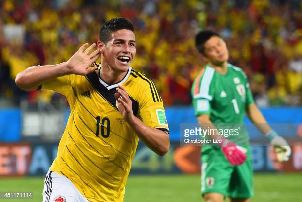 James Rodriguez of Colombia celebrates scoring his team's fourth goal past goalkeeper Eiji Kawashima of Japan during the 2014 FIFA World Cup Brazil...