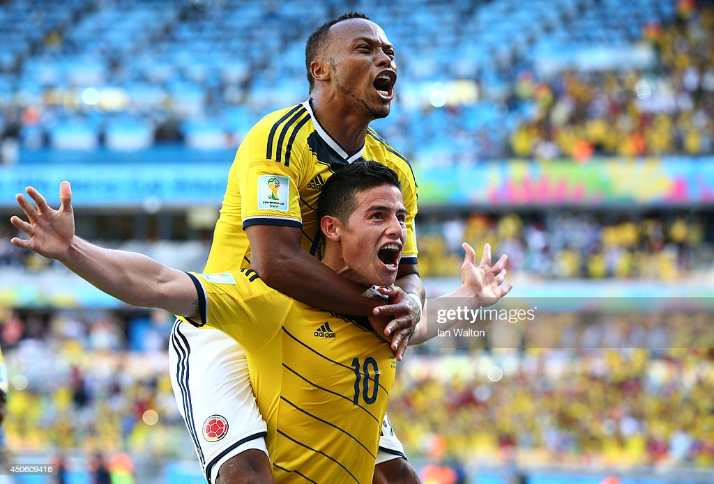 James Rodriguez of Colombia celebrates scoring his team's third goal with Juan Camilo Zuniga during the 2014 FIFA World Cup Brazil Group C match between Colombia and Greece at Estadio Mineirao on June 14, 2014 in Belo Horizonte, Brazil.