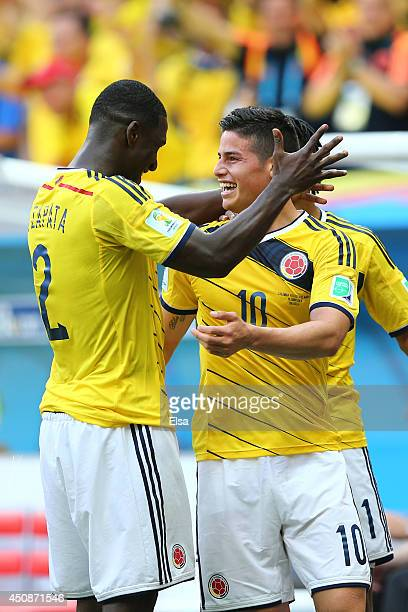 James Rodriguez of Colombia celebrates with Cristian Zapata after scoring his team's first goal during the 2014 FIFA World Cup Brazil Group C match...