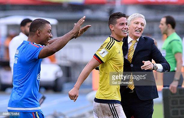 James Rodriguez of Colombia celebrates with Jose Pekerman head coach of Colombia after a goal scored by Macnelly Torres during a match between...