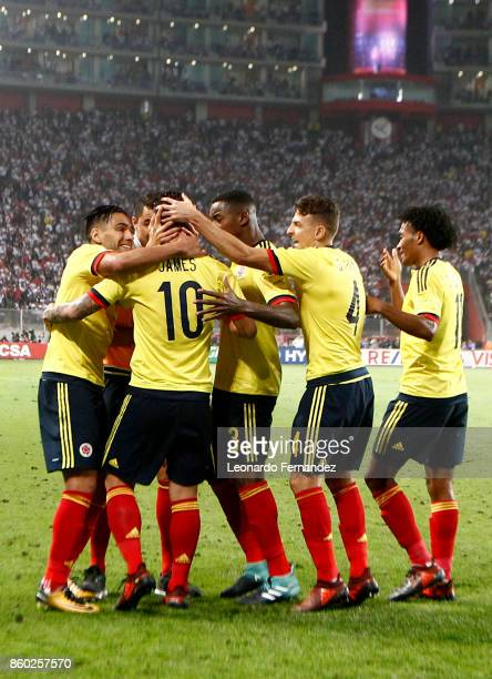 James Rodriguez of Colombia celebrates with Radamel Falcao and teammates after scoring the first goal of his team during match between Peru and...