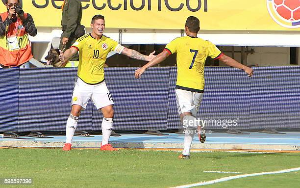 James Rodriguez of Colombia celebrates with teammate Carlos Bacca after socoring the opening goal during a match between Colombia and Venezuela as...