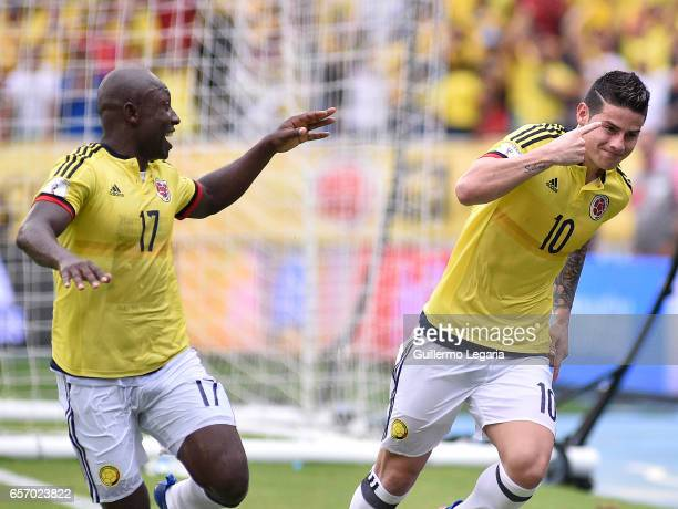 James Rodriguez of Colombia celebrates with teammate Pablo Armero after scoring the opening goal during a match between Colombia and Bolivia as part...