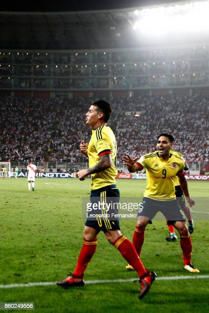 James Rodriguez of Colombia celebrates with teammate Radamel Falcao after scoring the first goal of his team during match between Peru and Colombia...