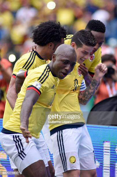 James Rodriguez of Colombia celebrates with teammates after scoring the opening goal during a match between Colombia and Bolivia as part of FIFA 2018...