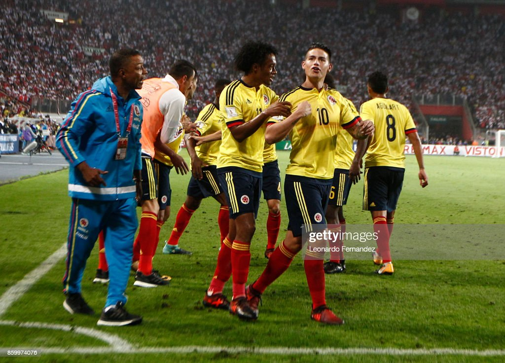 James Rodriguez of Colombia celebrates with teammates after scoring the first goal of his team during match between Peru and Colombia as part of FIFA 2018 World Cup Qualifiers at National Stadium on October 10, 2017 in Lima, Peru.