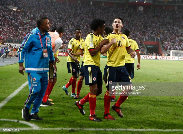 James Rodriguez of Colombia celebrates with teammates after scoring the first goal of his team during match between Peru and Colombia as part of FIFA...