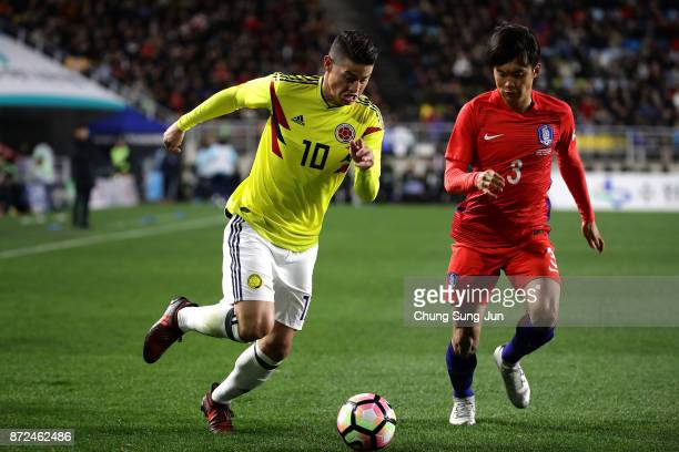 James Rodriguez of Colombia competes for the ball with Kim JinSu of South Korea during the international friendly match between South Korea and...