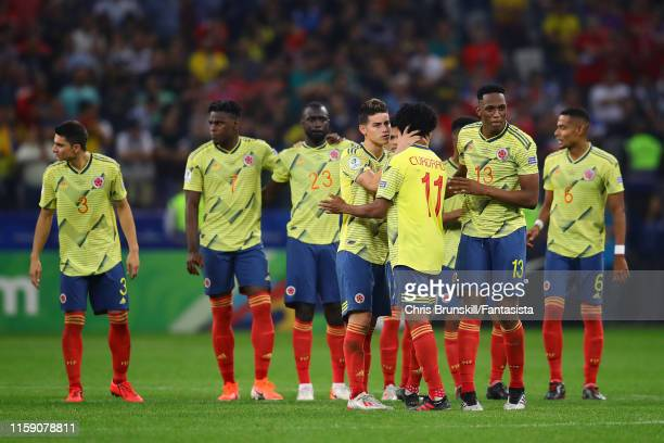James Rodriguez of Colombia embraces team-mate Juan Cuadrado after he scored during the penalty shoot-out following the Copa America Brazil 2019...