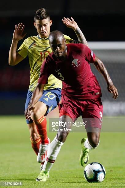 James Rodriguez of Colombia fights for the ball with Abdelkarim Hassan of Qatar during the Copa America Brazil 2019 group B match between Colombia...