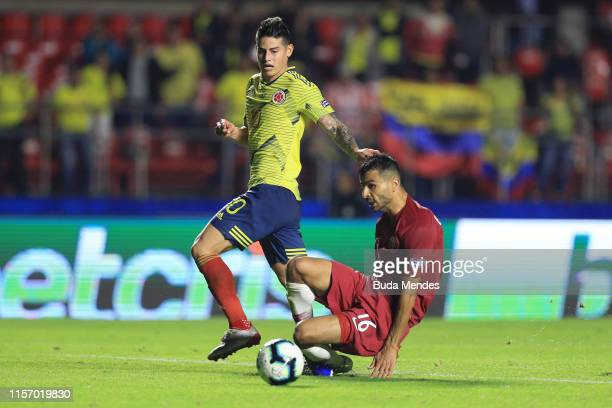 James Rodriguez of Colombia fights for the ball with Boualem Khoukhi of Qatar during the Copa America Brazil 2019 group B match between Colombia and...