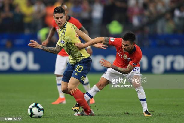 James Rodriguez of Colombia fights for the ball with Charles Aranguiz of Chile during the Copa America Brazil 2019 quarterfinal match between...
