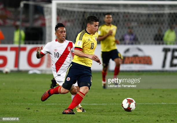 James Rodriguez of Colombia fights for the ball with Christian Cueva of Peru during match between Peru and Colombia as part of FIFA 2018 World Cup...