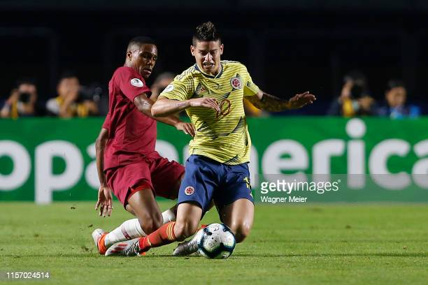 James Rodriguez of Colombia fights for the ball with RóRó of Qatar during the Copa America Brazil 2019 group B match between Colombia and Qatar at...