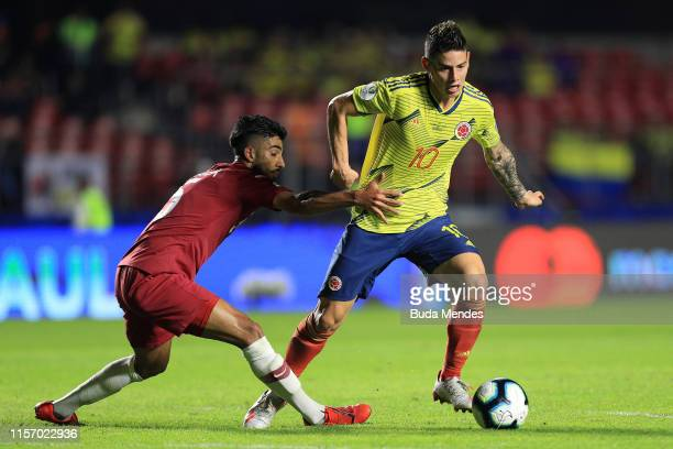 James Rodriguez of Colombia fights for the ball with Tarek Salman of Qatar during the Copa America Brazil 2019 group B match between Colombia and...
