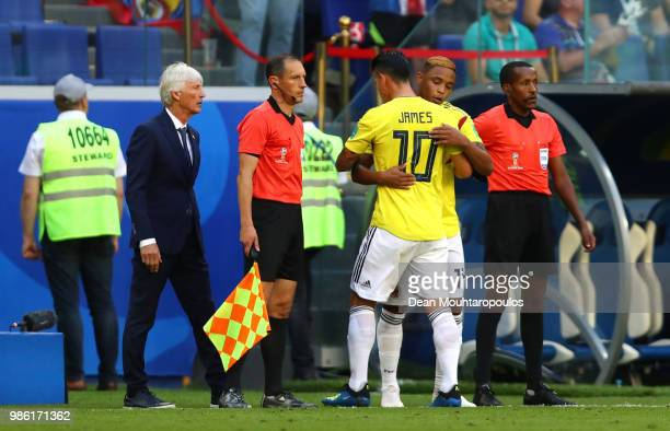 James Rodriguez of Colombia greets teammate Luis Muriel of Colombia as James Rodriguez is substituted off due to injury and Luis Muriel is...