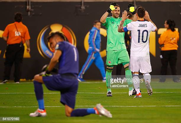 James Rodriguez of Colombia high fives goalkeeper David Ospina after scoring from the penalty spot past goalkeeper Pedro Gallese goalkeeper of Peru...
