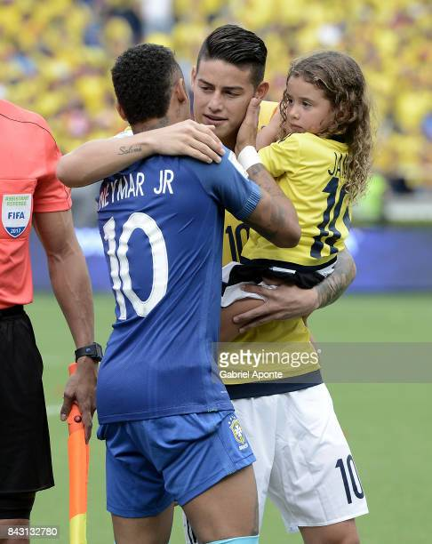 James Rodriguez of Colombia hugs Neymar Jr of Brazil prior a match between Colombia and Brazil as part of FIFA 2018 World Cup Qualifiers at...