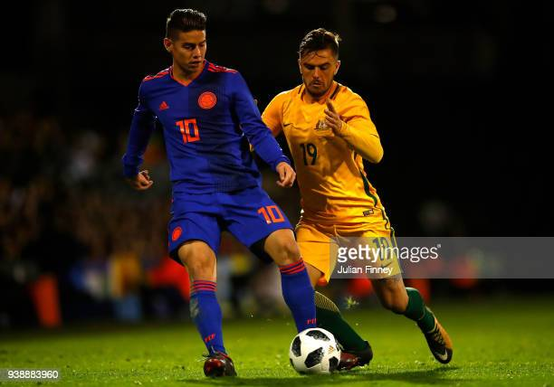 James Rodriguez of Colombia in action with Josh Risdon of Australia during the International Friendly match between Australia and Colombia at Craven...
