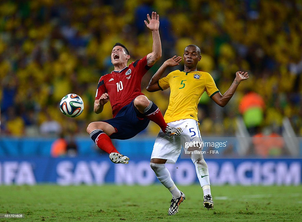 James Rodriguez of Colombia is broughtdown by Fernandinho of Brazil during the 2014 FIFA World Cup Brazil Quarter Final match between Brazil and Colombia at Estadio Castelao on July 4, 2014 in Fortaleza, Brazil.