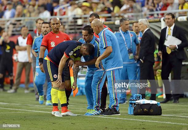 James Rodriguez of Colombia is looked t by the medical staff of Columbia during the 2016 Copa America Centenario Group match between the United...