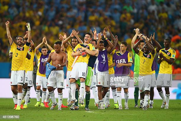 James Rodriguez of Colombia is picked up by goalkeeper David Ospina in celebration after defeating Uruguay 2-0 during the 2014 FIFA World Cup Brazil...