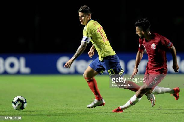 James Rodriguez of Colombia kicks the ball against Tarek Salman of Qatar during the Copa America Brazil 2019 group B match between Colombia and Qatar...