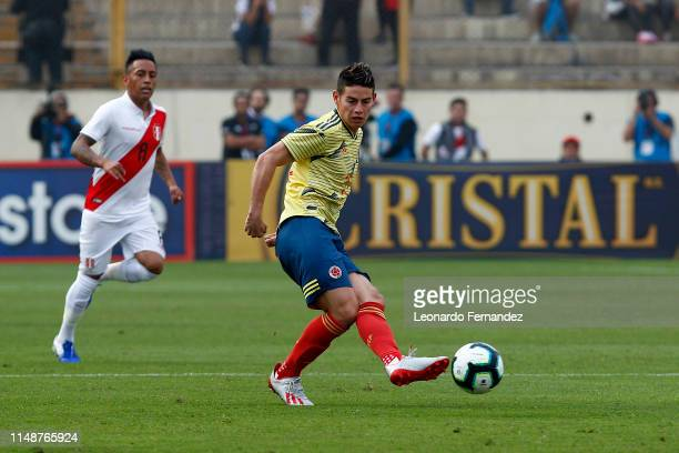 James Rodriguez of Colombia kicks the ball during a friendly match between Peru and Colombia at Estadio Nacional de Lima on June 9, 2019 in Lima,...