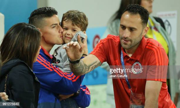 James Rodriguez of Colombia kisses Max Ospina the son of goalkeeper David Ospina when the players join their families in the stands more than an hour...