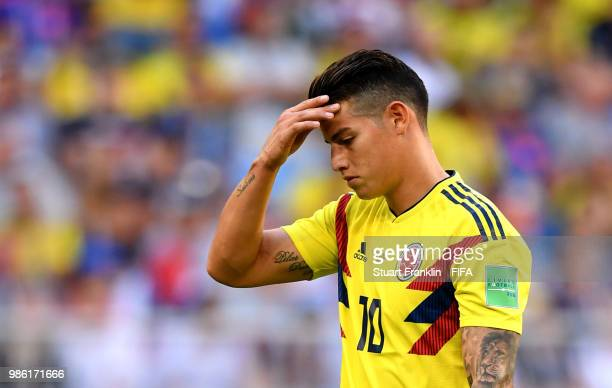 James Rodriguez of Colombia looks dejected as he is substituted off due to injury during the 2018 FIFA World Cup Russia group H match between Senegal...