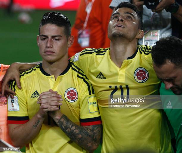 James Rodriguez of Colombia prays with Giovanni Moreno after the match between Peru and Colombia as part of FIFA 2018 World Cup Qualifiers at...