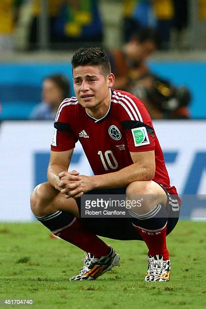 James Rodriguez of Colombia reacts after being defeated by Brazil 21 during the 2014 FIFA World Cup Brazil Quarter Final match between Brazil and...
