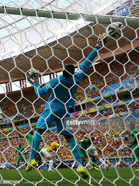 James Rodriguez of Colombia scores his team's first goal on a header past goalkeeper Boubacar Barry of the Ivory Coast during the 2014 FIFA World Cup...
