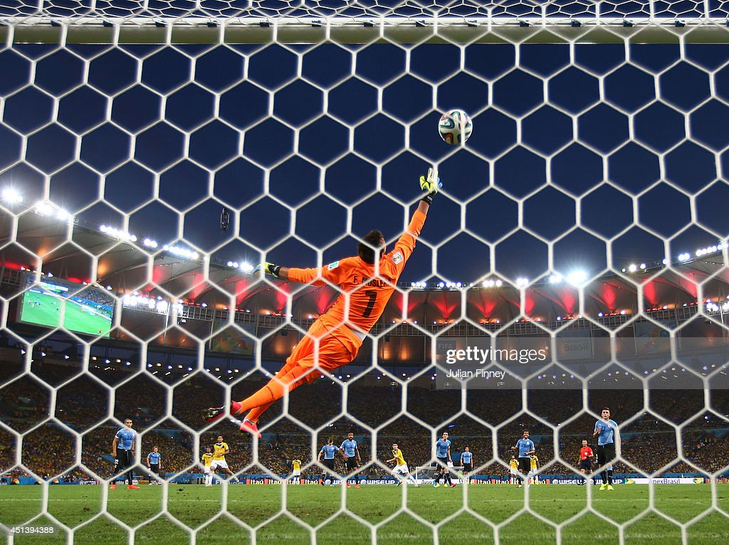 James Rodriguez of Colombia scores his team's first goal past Fernando Muslera of Uruguay during the 2014 FIFA World Cup Brazil round of 16 match between Colombia and Uruguay at Maracana on June 28, 2014 in Rio de Janeiro, Brazil.