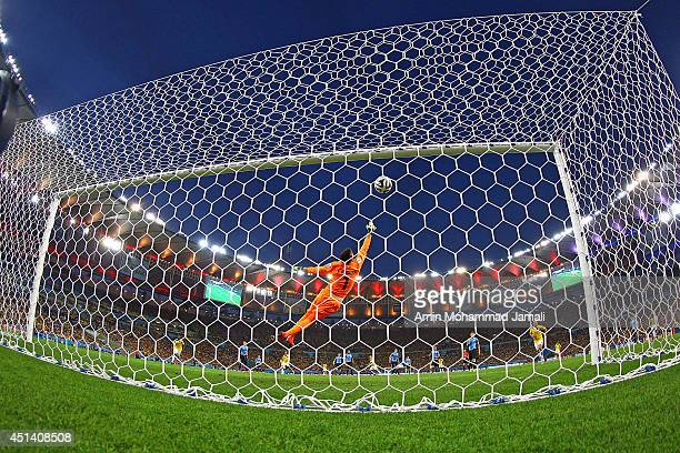 James Rodriguez of Colombia scores his team's first goal past Fernando Muslera of Uruguay during the 2014 FIFA World Cup Brazil round 16 match...