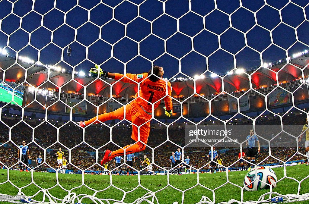 James Rodriguez of Colombia scores his team's first goal past Fernando Muslera of Uruguay during the 2014 FIFA World Cup Brazil round 16 match between Colombia and Uruguay at Maracana on June 28, 2014 in Rio de Janeiro, Brazil.