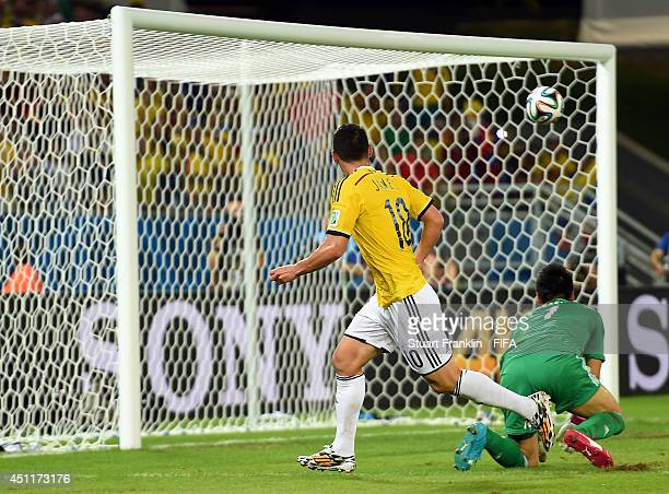 James Rodriguez of Colombia scores his team's fourth goal past Eiji Kawashima of Japan during the 2014 FIFA World Cup Brazil Group C match between...