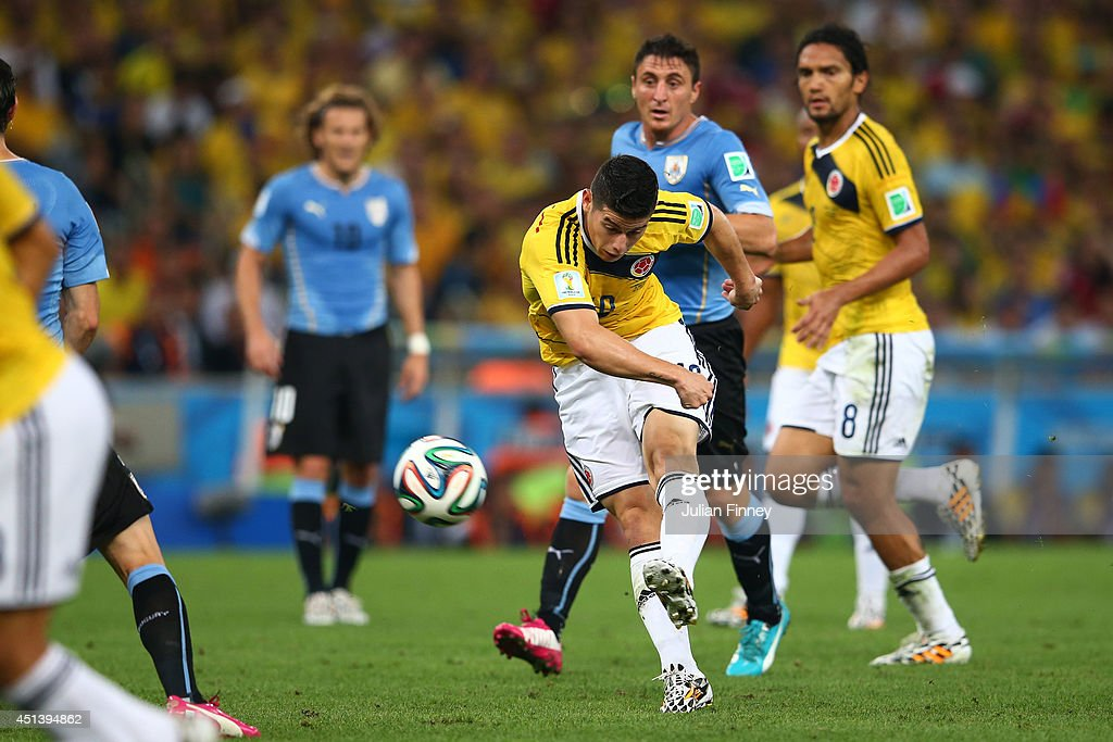 James Rodriguez of Colombia shoots and scoores his team's first goal during the 2014 FIFA World Cup Brazil round of 16 match between Colombia and Uruguay at Maracana on June 28, 2014 in Rio de Janeiro, Brazil.