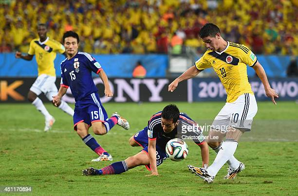 James Rodriguez of Colombia shoots and scores his team's fourth goal during the 2014 FIFA World Cup Brazil Group C match between Japan and Colombia...