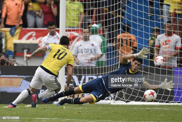 James Rodriguez of Colombia shoots to shoots to score the opening goal during a match between Colombia and Bolivia as part of FIFA 2018 World Cup...