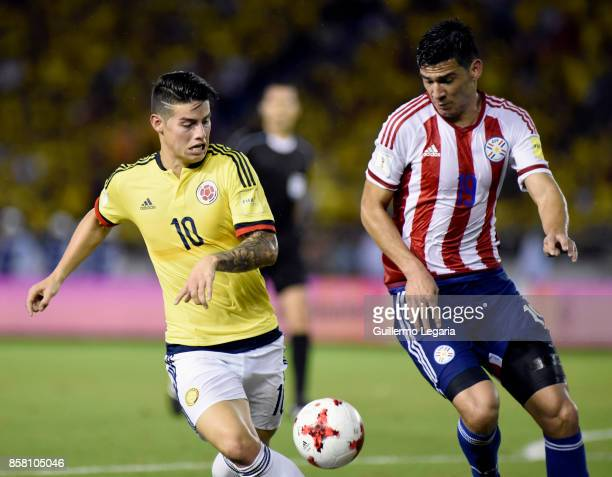 James Rodriguez of Colombia struggles for the ball with Fabian Balbuena of Paraguay during a match between Colombia and Paraguay as part of FIFA 2018...