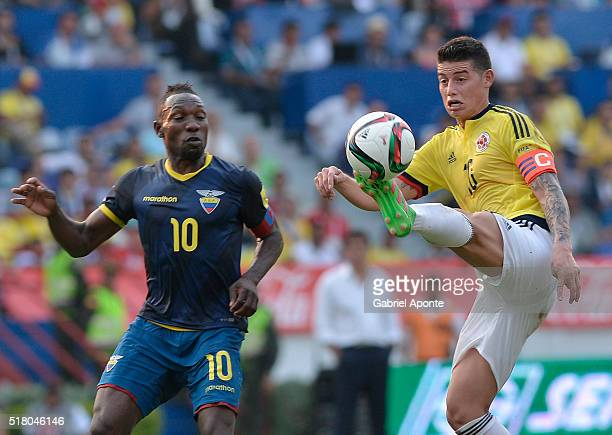 James Rodriguez of Colombia struggles for the ball with Walter Ayovi of Ecuador during a match between Colombia and Ecuador as part of FIFA 2018...