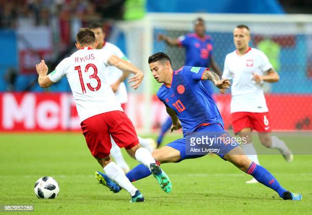 James Rodriguez of Colombia tackles Maciej Rybus of Poland during the 2018 FIFA World Cup Russia group H match between Poland and Colombia at Kazan...